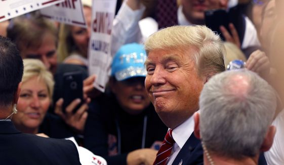 Republican presidential candidate Donald Trump smiles as he greets supporters after speaking at a campaign rally in New Orleans, Friday, March 4, 2016. (AP Photo/Gerald Herbert)