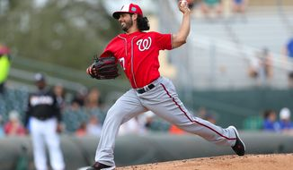 Washington Nationals pitcher Gio Gonzalez throws during the second inning of a spring training baseball game against the Miami Marlins Friday, March 4, 2016, at Roger Dean Stadium in Jupiter, Fla. (David Santiago/El Nuevo Herald via AP)  MAGS OUT; MANDATORY CREDIT