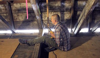 ADVANCE FOR SUNDAY, MARCH 6, 2016- In this Friday, Feb. 19, 2016 photo, Grant Harley, Assistant Professor, Geography and Geology at University of Southern Mississippi, takes a core sample from wooden beams at the LaPointe-Krebs House in Pascagoula, Miss. A crew from USM and its Dendron Lab are taking samples of the wood from the building in hopes of dating the material used to built the historic structure. (Tim Isbell /The Sun Herald via AP) LOCAL TELEVISION OUT; MANDATORY CREDIT: MISSISSIPPI PRESS OUT; LOCAL TELEVISION OUT WLOX, LOCAL ONLINE OUT; GULFLIVE.COM OUT