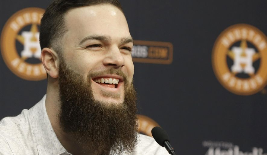 FILE - In this Nov. 19, 2015, file photo, Houston Astros pitcher Dallas Keuchel speaks at a press conference in Houston, the day after winning the AL Cy Young Award. Houston's ace is proud of his personal accomplishments but he won't be satisfied until he leads the Astros to a championship. (AP Photo/Pat Sullivan, File)