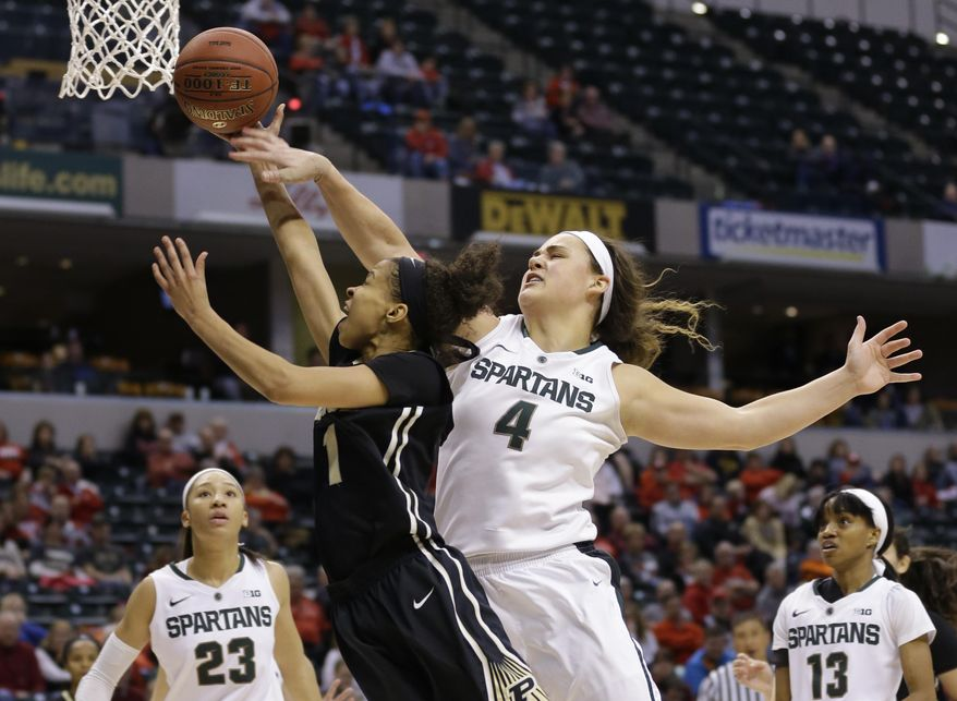 Michigan State center Jasmine Hines (4) fouls Purdue guard Ashley Morrissette (1) as she shoots in the second half of an NCAA college basketball game at the Big Ten Conference tournament in Indianapolis, Friday, March 4, 2016. Michigan State defeated Purdue 65-64. (AP Photo/Michael Conroy)