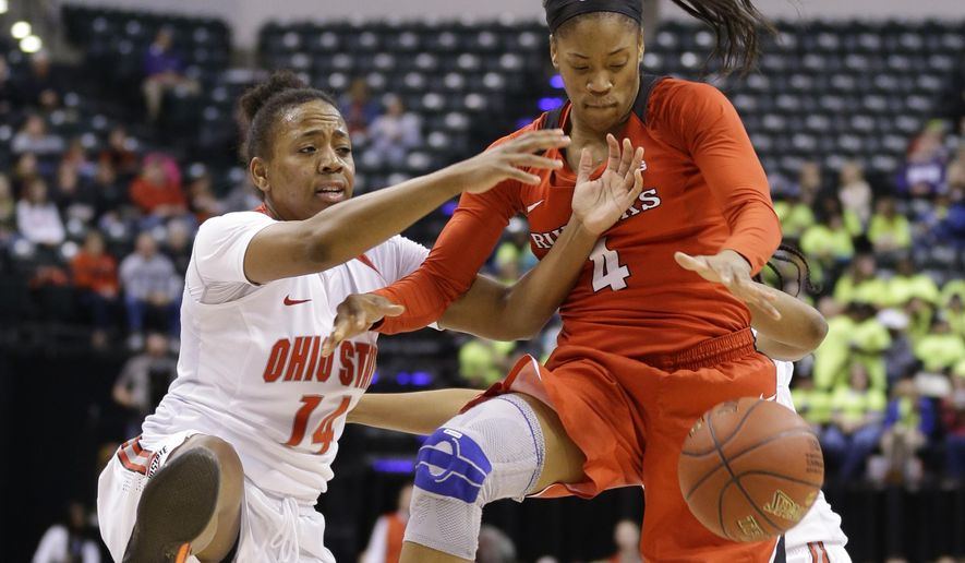 Ohio State guard Ameryst Alston (14) and Rutgers guard Briyona Canty (4) battle for a rebound in the second half of an NCAA college basketball game at the Big Ten Conference tournament in Indianapolis, Friday, March 4, 2016. Ohio State defeated Rutgers 73-58. (AP Photo/Michael Conroy)