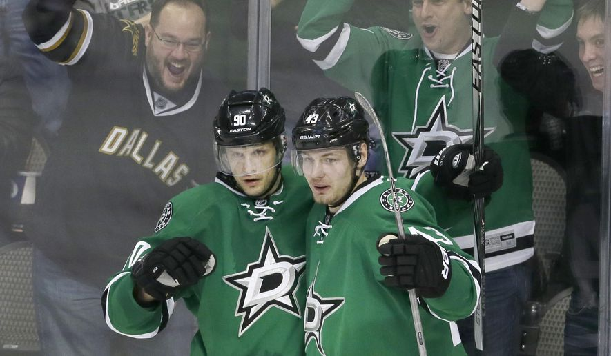 Dallas Stars center Jason Spezza (90) celebrates his goal with teammate Valeri Nichushkin (43) during the second period of an NHL hockey game against the New Jersey Devils Friday, March 4, 2016, in Dallas. (AP Photo/LM Otero)
