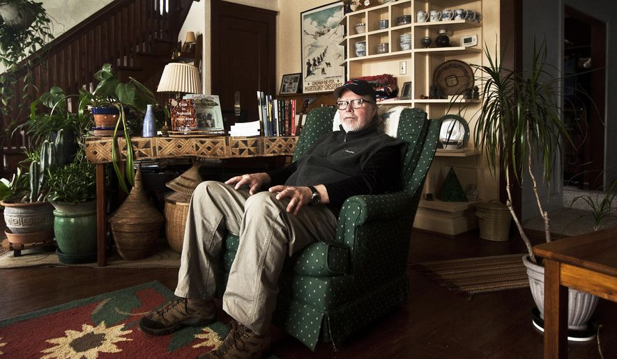 ADVANCE FOR MONDAY MARCH 7 - In this Feb. 18, 2016 photo, Tom Driscoll, managing editor and CEO of Shipwreckt Books Publishing Company, sits for a photo inside the living room of his home in Rushford, Minn. (Chuck Miller/The Winona Daily News via AP) MANDATORY CREDIT