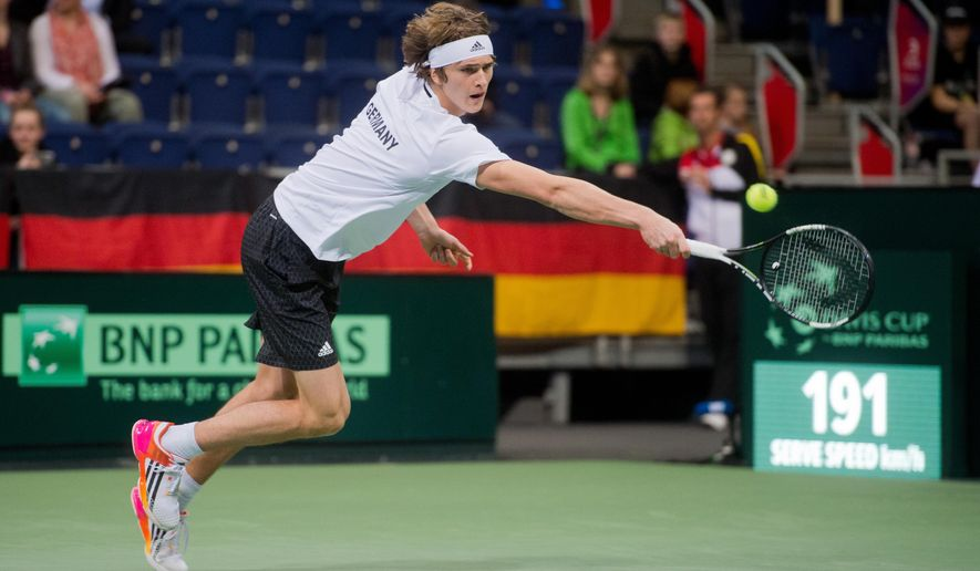 Germany's Alexander Zverev  returns a ball during  the tennis match against Czech Republic's  Tomas Berdych at the World Group 1st round of the Davis Cup in Hannover, Germany,  Friday March 4, 2016. (Julian Stratenschulte/dpa via AP)