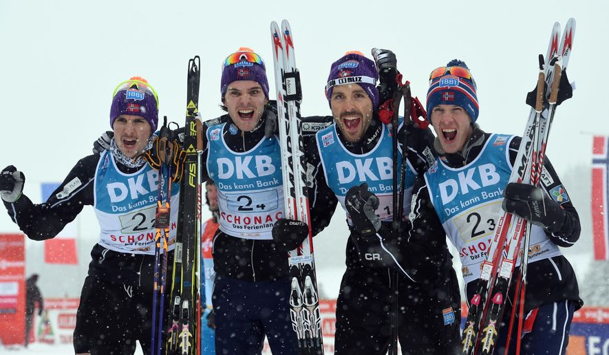 Norway's winning team  from left: Jan Schmid, Joergen Graabak, Magnus Moan and Magnus Krog  posing after the team competition at the Nordic Combined World Cup  in Schonach, Germany, Friday March 4, 2016. (Patrick Seeger/dpa via AP)