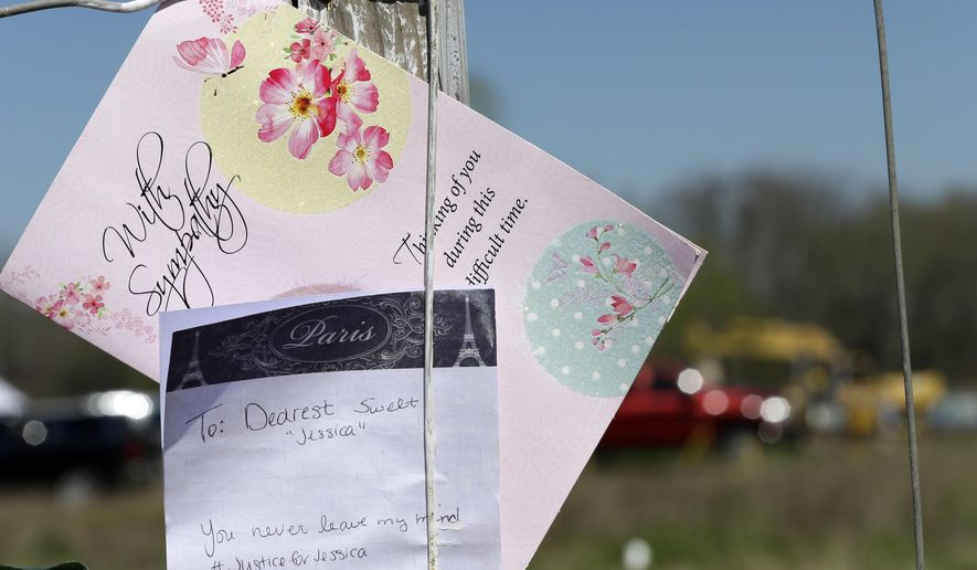 A card and note hang on a fence surrounding the area where authorities continue to search for human remains near Houston, Friday, March 4, 2016. A convicted kidnapper who may be linked to other violent crimes has been temporarily released from prison to help authorities who are digging for the body of a teenager who disappeared two decades ago. William Reece's attorney says his client is helping authorities locate the body of 17-year-old Jessica Cain, one of multiple people Reece may have victimized in 1997. (AP Photo/David J. Phillip)