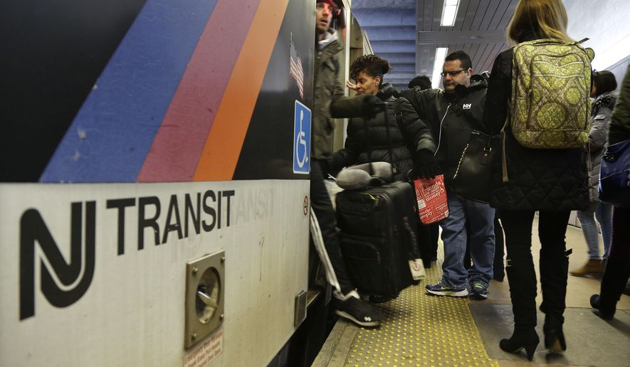 New Jersey Transit passengers board a train at Seacaucus Junction, Friday, March 4, 2016, in Seacaucus, N.J. Officials representing New Jersey Transit and rail workers unions met in front of the National Mediation Board in Washington on Friday to try and avert a system-wide rail strike next weekend. (AP Photo/Julie Jacobson)