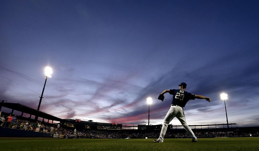 San Diego Padres starting pitcher Colin Rea warms up in the outfield before the team's spring training baseball game against the Kansas City Royals on Friday, March 4, 2016, in Peoria, Ariz. (AP Photo/Charlie Riedel)