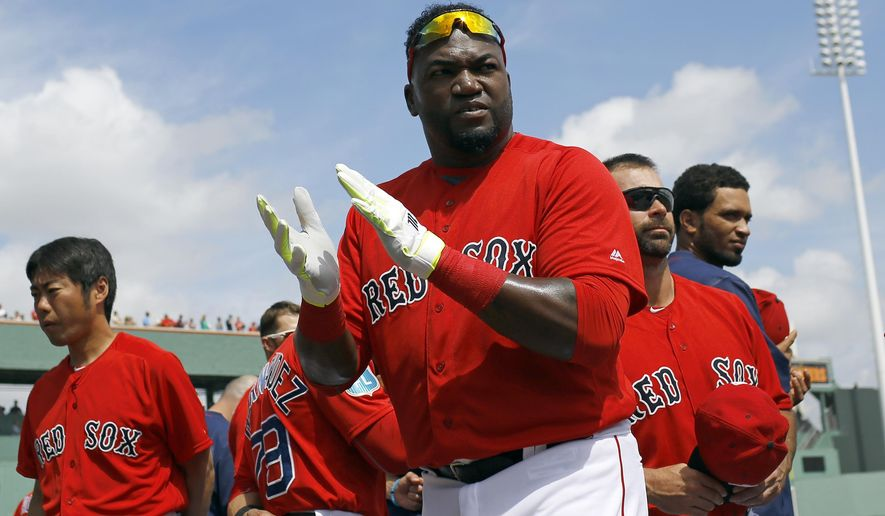 Boston Red Sox designated hitter David Ortiz, center, walks on the field before a spring training baseball game against the Tampa Bay Rays in Fort Myers, Fla., Friday, March 4, 2016. (AP Photo/Patrick Semansky)