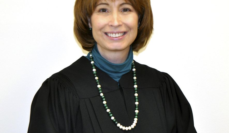 This photo provided by the U.S. Court of Appeals District of Columbia Circuit shows Judge Patricia Millett in August 2014, in Washington. Millett knows how to fight. The potential Supreme Court nominee earned a second-degree black belt in tae kwon do. But nothing, not her 32 Supreme Court arguments, not her difficult confirmation to become a federal judge and not her 15 years working in government, may prepare her for the showdown set for any nomination President Barack Obama makes to the court to replace Justice Antonin Scalia, who died last month, (U.S. Court of Appeals District of Columbia Circuit via AP)