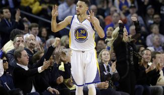 Golden State Warriors' Stephen Curry celebrates after scoring against the Oklahoma City Thunder during the first half of an NBA basketball game Thursday, March 3, 2016, in Oakland, Calif. (AP Photo/Marcio Jose Sanchez)