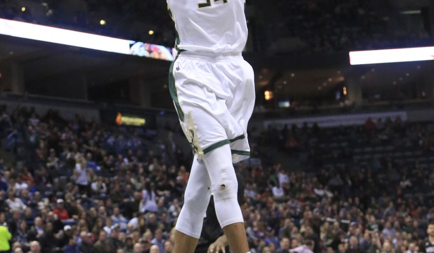 Milwaukee Bucks forward Giannis Antetokounmpo gets a break away slam dunk against the Minnesota Timberwolves during the second half of an NBA basketball game Friday, March 4, 2016, in Milwaukee. (AP Photo/Darren Hauck)