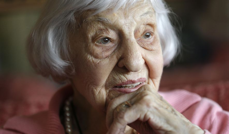 In this Tuesday, March 1, 2016 photo, Amelia Greeley reflects on her time spent as an Army nurse during World War II in the South Pacific, in New York. Greeley, who goes by Mimi, celebrated her 100th birthday this week and will be sharing the milestone with a friend she made nearly 70 years ago during the war. (AP Photo/Julie Jacobson)