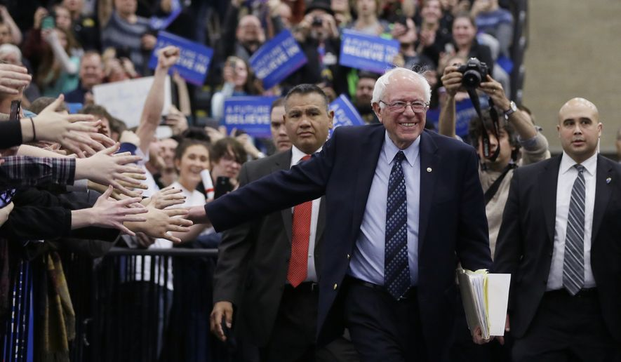 Democratic presidential candidate, Sen. Bernie Sanders, I-Vt, arrive for a rally at the Macomb Community College, Saturday, March 5, 2016, in Warren, Mich. (AP Photo/Carlos Osorio)