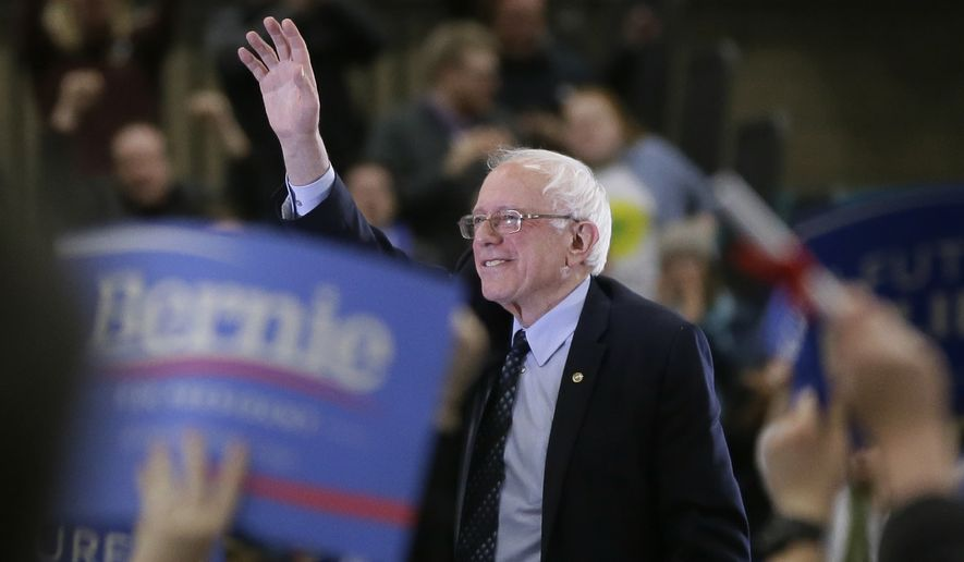 Democratic presidential candidate, Sen. Bernie Sanders, I-Vt, acknowledges the crowd after speaking at a rally at the Macomb Community College, Saturday, March 5, 2016, in Warren, Mich. (AP Photo/Carlos Osorio)