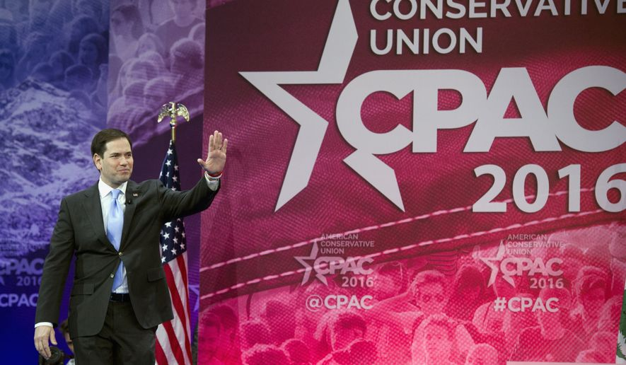 Republican presidential candidate, Sen. Marco Rubio, R-Fla. waves as he walks onstage to address the American Conservative Union's Conservative Political Action Conference (CPAC) in National Harbor, Md., Saturday, March 5, 2016. (AP Photo/Cliff Owen)