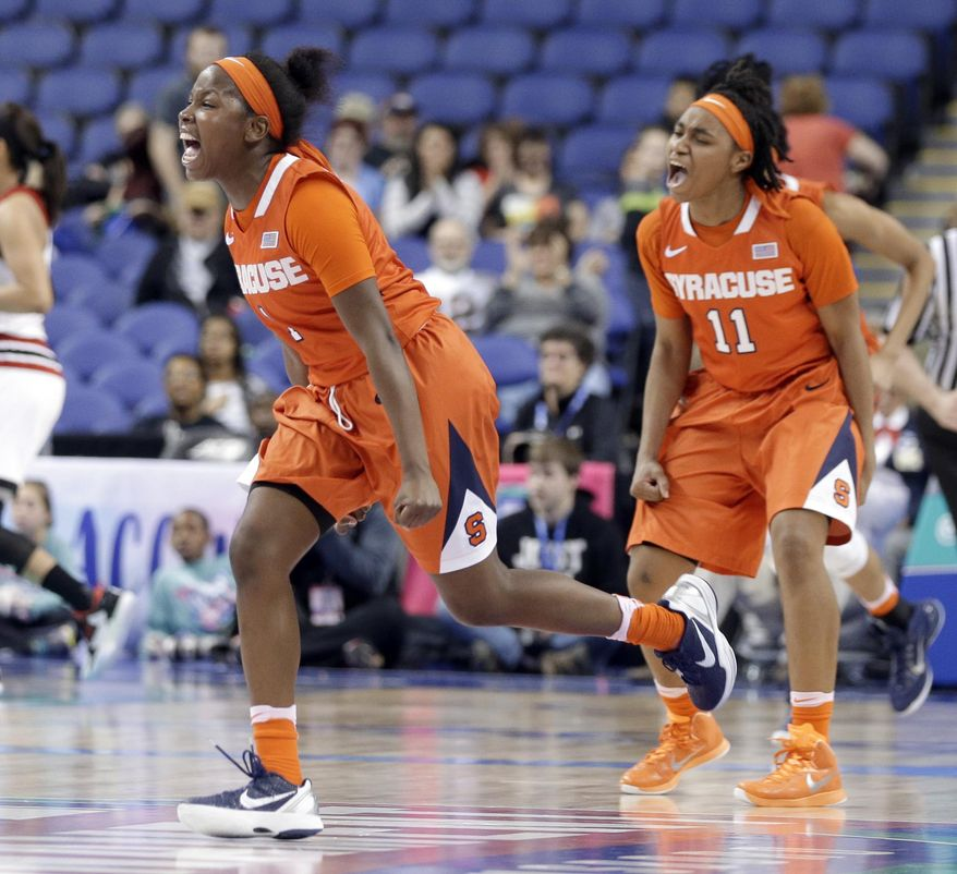Syracuse's Alexis Peterson (1) and Cornelia Fondren (11) celebrate after an NCAA college basketball game against Louisville in the Atlantic Coast Conference tournament in Greensboro, N.C., Saturday, March 5, 2016. Syracuse won 80-75. (AP Photo/Chuck Burton)