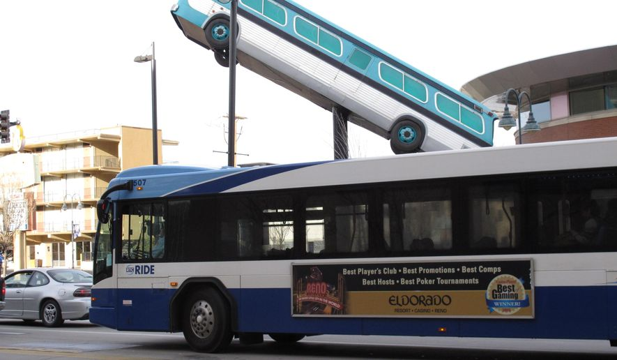 A city bus passes the sculpture in front of the bus station in downtown Reno, Nevada on Wednesday, March 2, 2016. Washoe County's Regional Transportation Commission and the union representing its bus drivers are locked in a 2-year-old legal battle over whether expanding the audio reach of the bus surveillance recordings amounts to illegal eavesdropping on passengers. (AP Photo/Scott Sonner).