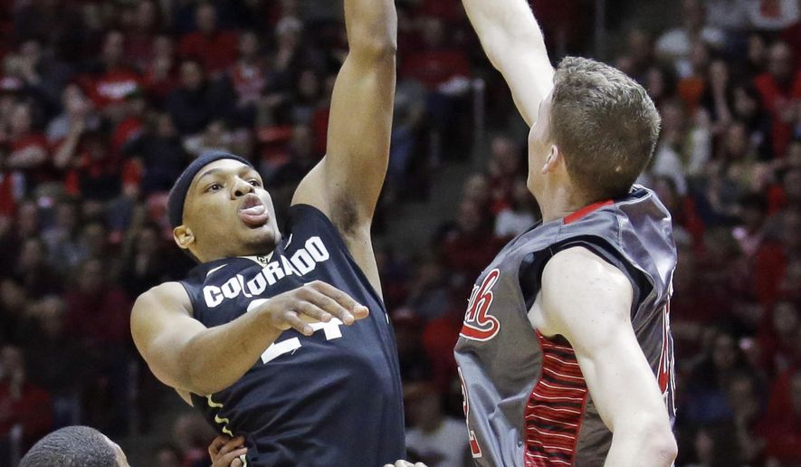 Colorado guard George King, left, shoots as Utah forward Jakob Poeltl, right, defends during the first half in an NCAA basketball game Saturday, March 5, 2016, in Salt Lake City. (AP Photo/Rick Bowmer)