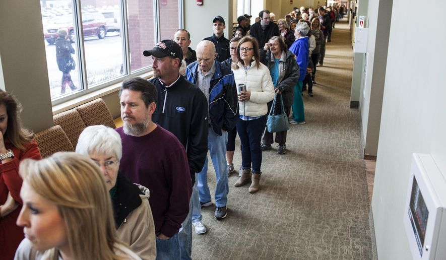 Voters stand in line at the Republican caucus Saturday, March 5, 2016 at the Knicely Center in Bowling Green, Ky. The rambunctious Republican race for president comes to Kentucky on Saturday with a little-publicized caucus that has some party leaders worrying about low turnout.(Austin Anthony/Daily News via AP) MANDATORY CREDIT