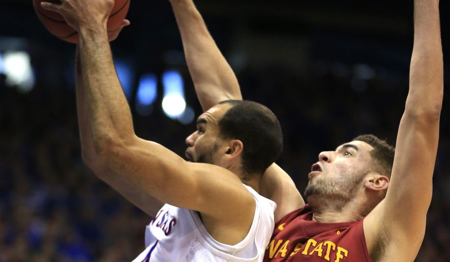 Kansas forward Perry Ellis, left, is fouled by Iowa State forward Georges Niang (31) during the first half of an NCAA college basketball game in Lawrence, Kan., Saturday, March 5, 2016. (AP Photo/Orlin Wagner)