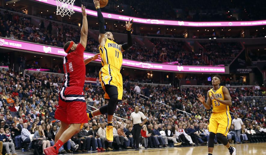Indiana Pacers guard Monta Ellis (11) shoots over Washington Wizards forward Jared Dudley (1) during the first half of an NBA basketball game Saturday, March 5, 2016, in Washington. (AP Photo/Alex Brandon)