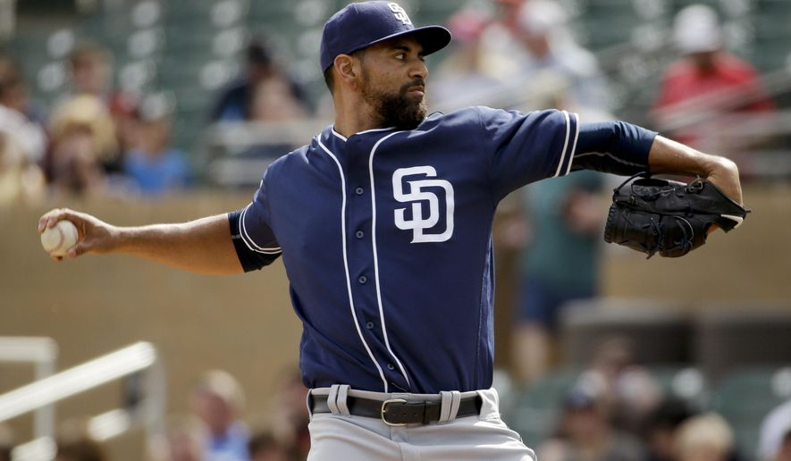 San Diego Padres starting pitcher Tyson Ross throws against the Colorado Rockies during first inning of a spring baseball game in Scottsdale, Ariz., Saturday, March 5, 2016. (AP Photo/Chris Carlson)