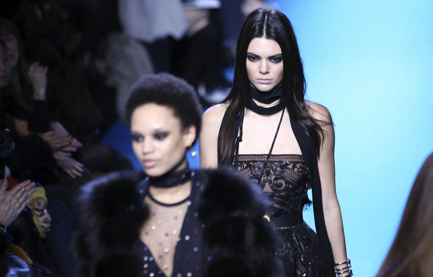 Model Kendall Jenner wears a creation for Elie Saab's fall-winter 2016-2017 ready to wear fashion collection presented Saturday, March 5, 2016 in Paris.  (AP Photo/Vianney le Caer)