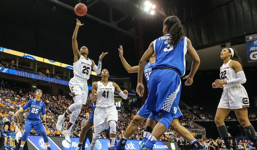 South Carolina guard Tiffany Mitchell (25) shoots the ball in front of teammate center Alaina Coates (41) against Kentucky during an NCAA college basketball game in the Southeastern Conference women's tournament semifinal in Jacksonville, Fla., Saturday, March 5, 2016. (AP Photo/Gary McCullough)