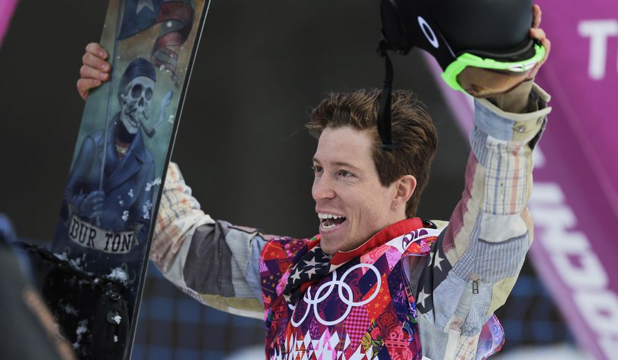 FILE - In this Feb. 11, 2014 file photo, Shaun White waves to the crowd after a run during the men's snowboard halfpipe qualifying at the Winter Olympics, in Krasnaya Polyana, Russia. White turns 30 later this year, and the world's most famous snowboarder is celebrating by stamping his name all over the business side of the world he's helped create. (AP Photo/Andy Wong, file)