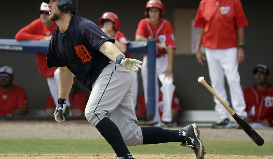 Detroit Tigers' Bryan Holaday watches his hit clear the left field wall for a home run against the Washington Nationals in the fourth inning in a spring training baseball game, Saturday, March 5, 2016, in Viera, Fla. (AP Photo/John Raoux)