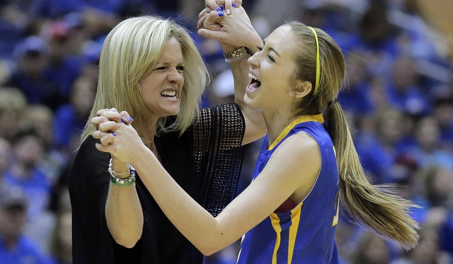 Lipan's Lanie Roberts, right, celebrates with her coach Amber Branson, left, during a UIL Class 1A girls high school state final basketball game against Nazareth, Saturday, March 5, 2016, in San Antonio. Lipan won 54-43.  (AP Photo/Eric Gay)