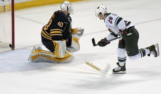 Buffalo Sabres goaltender Robin Lehner (40) gets beat as Minnesota Wild left winger Jason Pominville (29) for the game-winning goal in a shootout during an NHL hockey game, Saturday, March 5, 2016, in Buffalo, N.Y.  Minnesota won 3-2 in a shootout. (AP Photo/Gary Wiepert)