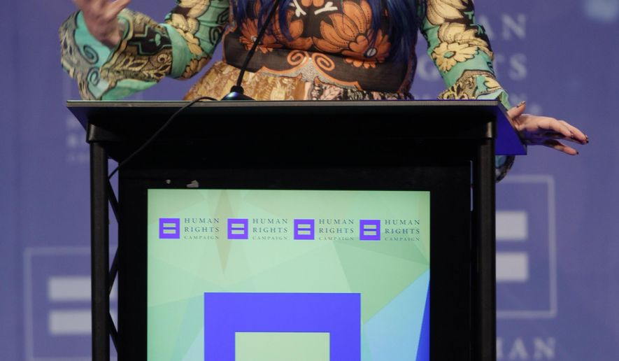 Kesha, recipient of the Visibility award, speaks at the 21st Annual HRC Nashville Equality Dinner at the Renaissance Hotel on Saturday, March 5, 2016, in Nashville, Tenn. (Photo by Wade Payne/Invision/AP)