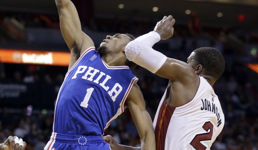 Philadelphia 76ers guard Ish Smith (1) goes to the basket against Miami Heat forward Joe Johnson (2) during the first half of an NBA basketball game, Sunday, March 6, 2016, in Miami. (AP Photo/Alan Diaz)