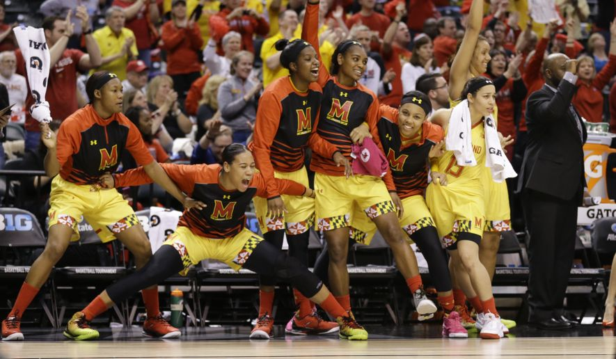 The Maryland bench celebrates in the second half of an NCAA college basketball game against Michigan State in the finals of the Big Ten Conference tournament in Indianapolis, Sunday, March 6, 2016. Maryland defeated Michigan State 60-44. (AP Photo/Michael Conroy)