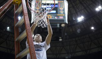 George Washington's Camila Tapias cuts down a portion of the net after her team's win over Duquesne during an NCAA college basketball game against Duquesne in the championship of the Atlantic 10 Conference tournament Sunday, March 6, 2016, in Richmond, Va. (AP Photo/Chet Strange)