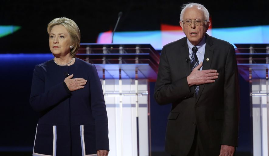 At a Democratic presidential primary debate in Flint, Mich., Hillary Clinton joined rival Sen. Bernard Sanders' demand that Michigan Gov. Rick Snyder, a Republican, step down immediately. (Associated Press)