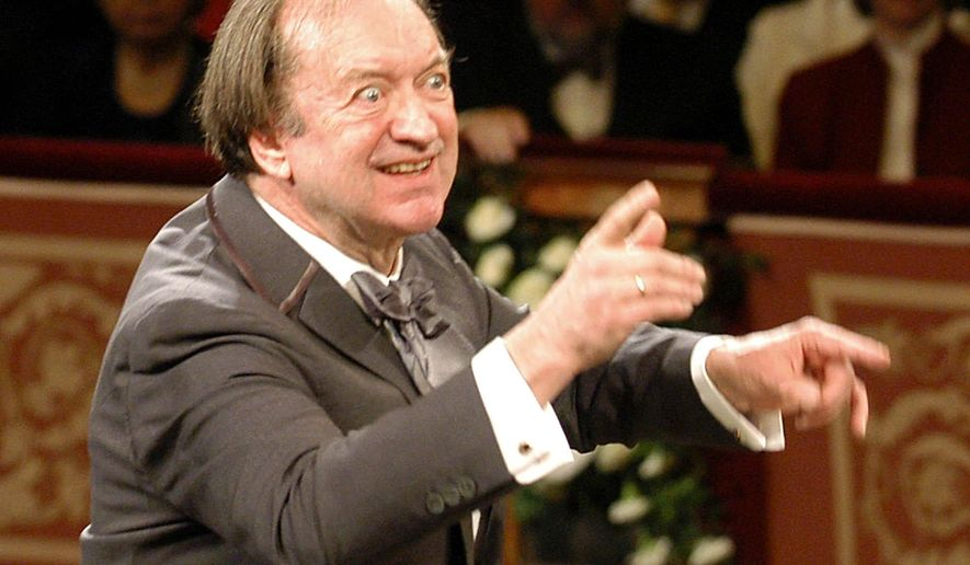 FILE In this Jan. 1, 2003 file picture Nikolaus Harnoncourt conducts the Vienna Philharmonic Orchestra during the traditional New Year's concert at the Musikverein in Vienna, Austria. Conductor Nikolaus Harnoncourt is dead after a career characterized by a search for authenticity in Baroque and other classical music. His death at 87 Saturday night was confirmed Sunday March 6, 2016  by the Gesellschaft der Musikfreunde in Wien (Society of Friends of Music in Vienna,) which was closely associated with Harnoncourt.  (AP Photo/Terry,file)
