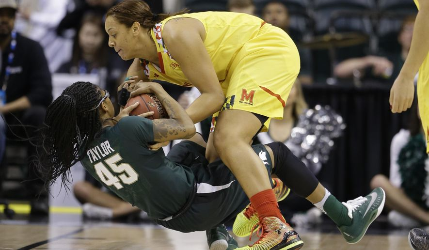 Michigan State forward Akyah Taylor (45) and Maryland center Malina Howard (5) battle for a rebound in the first half of an NCAA college basketball game in the finals of the Big Ten Conference tournament in Indianapolis, Sunday, March 6, 2016. (AP Photo/Michael Conroy)