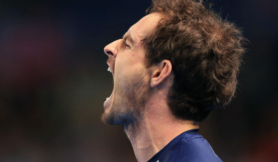 Great Britain's Andy Murray reacts as he plays Japan's  Kei Nishikori, during the first round singles match between Great Britain and Japan, at the Barclaycard Arena, in Birmingham, England, Sunday March 6, 2016. (Mike Egerton/PA via AP) UNITED KINGDOM OUT