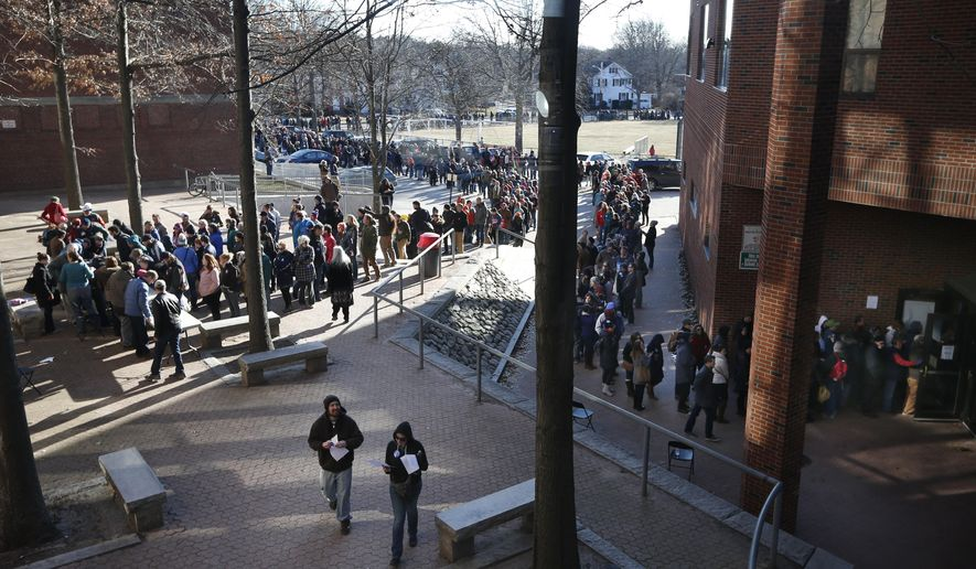 Voters, some of whom waited more than five hours, stand in line that stretched well over one half-mile long to get into a Democratic caucus location at Deering High School, Sunday, March 6, 2016, in Portland, Maine. Several thousand voters showed up to choose between Democratic presidential candidates Hillary Clinton and Bernie Sanders, who're vying to represent the party in the general election. (AP Photo/Robert F. Bukaty)