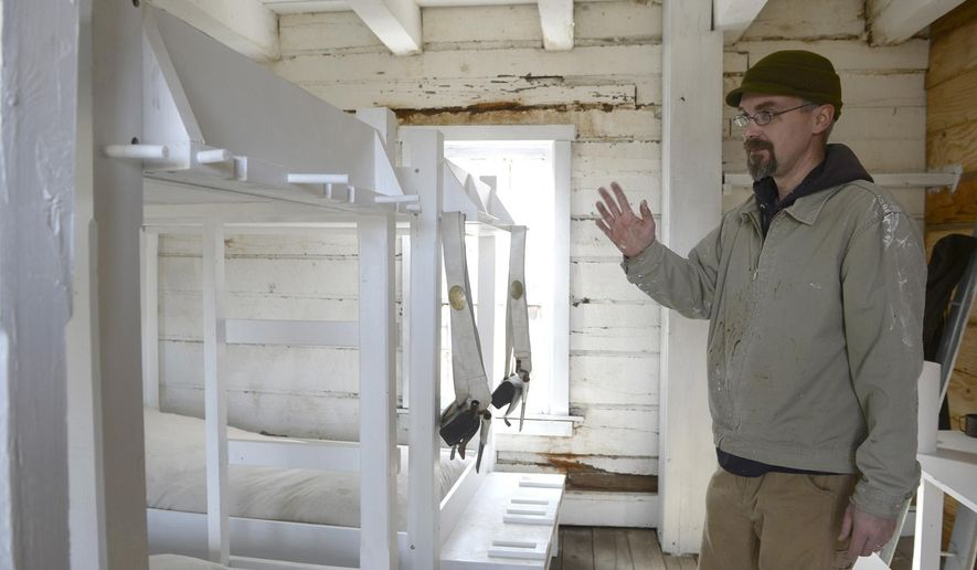 ADVANCE FOR SUNDAY MARCH 6 - In this Monday, Feb. 29, 2016 photo, Dr. Eugene Watkins, of Fort Madison, shows some of the new repairs that is being worked on in the barracks at the Old Fort Madison in Fort Madison, Iowa. Part of Old Fort Madison has a new look for the approaching tourism season. With the first $5,000 installment of a Midwest One grant the fort received last year, site curator Eugene Watkins and site employee Franz Hoenig have been creating more accurate depictions of rooms in the soldier's barracks, including bunk beds and white-washed walls and decor. (Jeff Brown/The Hawk Eye via AP) MANDATORY CREDIT