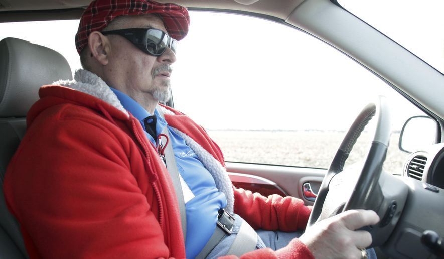 ADVANCE FOR WEEKEND EDITIONS MARCH 5-6 - In this undated photo, Gary Wiles drives for Camelot Transportation in Kearney, Neb.. He and his wife Angela transport all sorts of clients across the state. Their main transports include foster children who they take to and from their parents. (Jeff Damron/The Daily Hub via AP) MANDATORY CREDIT