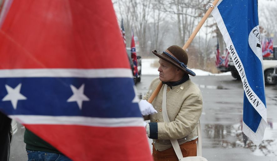 Jim Perkins of Blanchard, Mich., talks during a Confederate flag rally Saturday afternoon, March 5, 2016, in a carpool lot in Columbia Township, southwest of Detroit. About 30 people from across the state gathered with flags. (J. Scott Park/Jackson Citizen Patriot via AP))