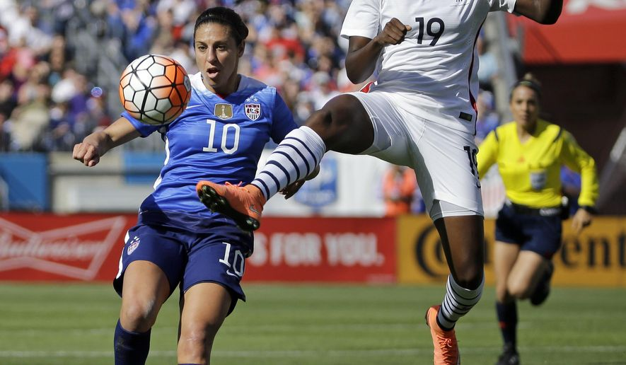 France's defender Griedge Mbock Bathy (19) kicks the ball away from United States' midfielder Carli Lloyd (10) during the first half of a SheBelieves Cup women's soccer match Sunday, March 6, 2016, in Nashville, Tenn. (AP Photo/Mark Humphrey)