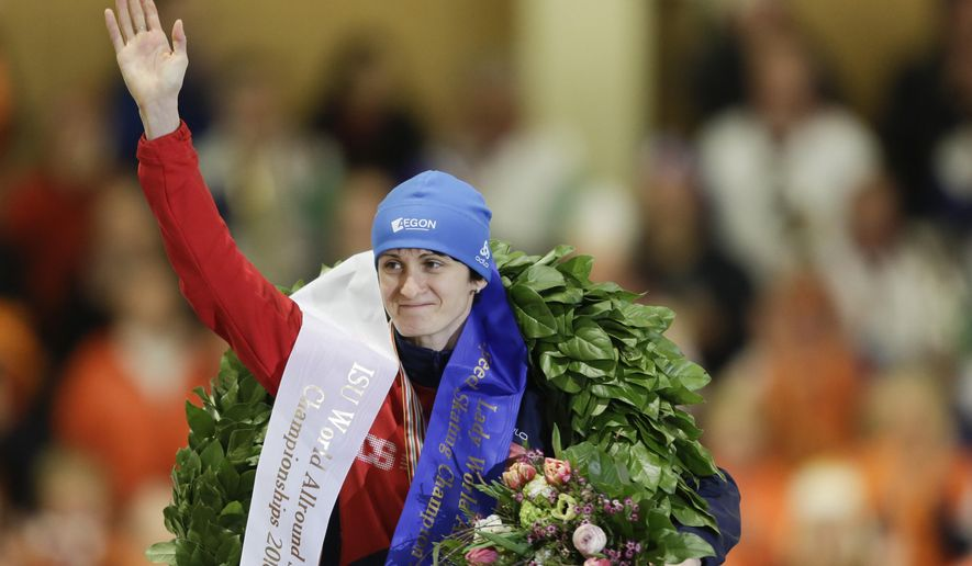 Martina Sablikova from the Czech Republic celebrates during the winners ceremony after she won  the ISU World Allround Speed Skating Championships in Berlin, Germany, Sunday, March 6, 2016.  (AP Photo/Markus Schreiber)