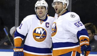 New York Islanders' Johnny Boychuk, right, celebrates his first goal with John Tavares during the first period of the NHL hockey game against the New York Rangers, Sunday, March 6, 2016, in New York. (AP Photo/Seth Wenig)