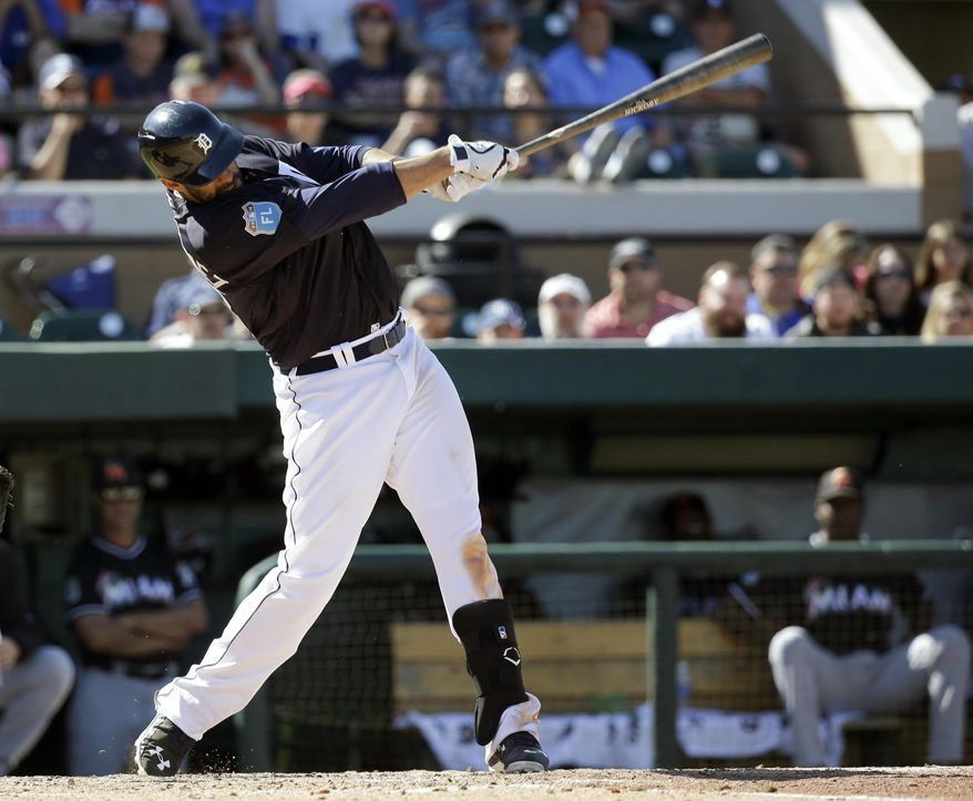 Detroit Tigers' J.D. Martinez hits a home run against the Miami Marlins in the fifth inning of a spring training baseball game, Sunday, March 6, 2016, in Lakeland, Fla. (AP Photo/John Raoux)